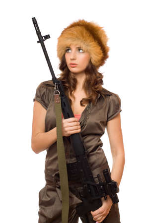Hot young woman holding a rifle. Isolated photo
