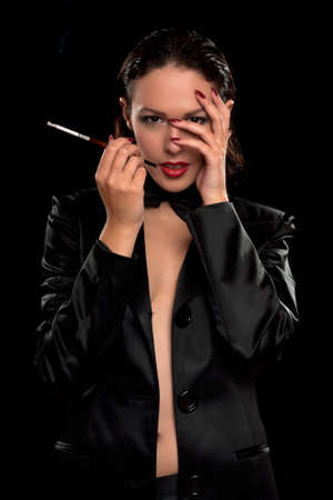 Sensual young woman with cigarette  Isolated on black Stock Photo - 12621755