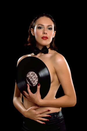 Gorgeous young woman topless with vinyl  Isolated on black photo