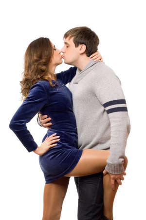 Boy kissing his lovely girl in a sexy pose Stock Photo - 12621770