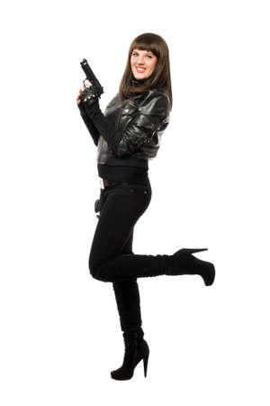 Sexy girl in black posing with a gun photo