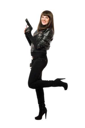 Sexy girl in black posing with a gun photo