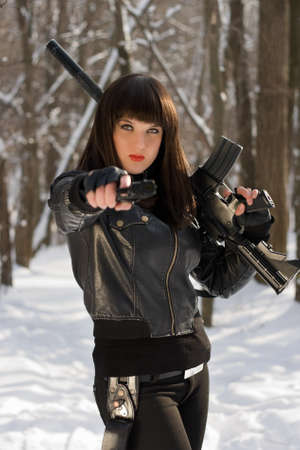 silencer: Portrait of young woman with weapon in their hands Stock Photo