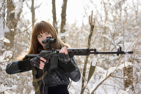 gun sight: Brunette girl pointing out with a gun
