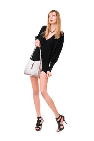 Sensual beautiful girl with the white purse Stock Photo - 12622070