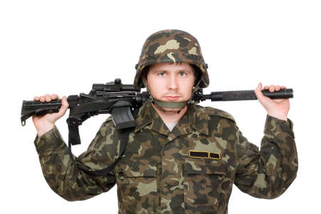 Armed soldier with m16 on the shoulders photo