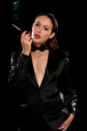 Portrait of a elegant young brunette with cigarette. Isolated photo