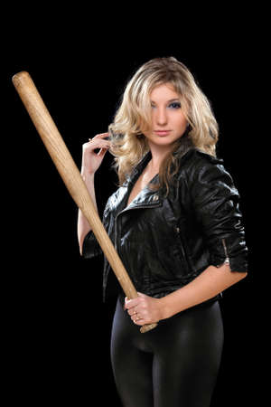 Seductive young blonde with a bat in their hands. Isolated