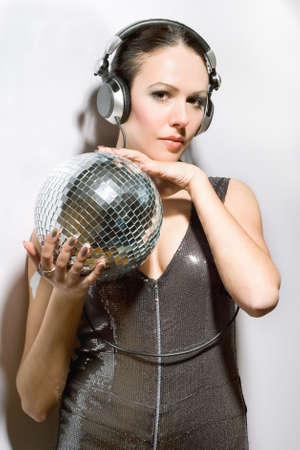 Portrait of beautiful brunette with a mirror ball in her hands photo
