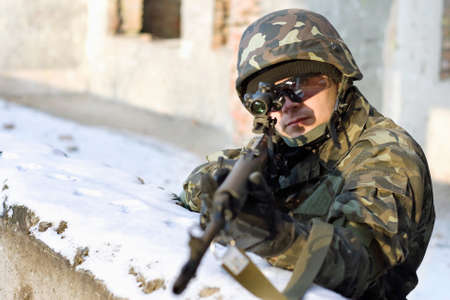 Soldier who aim at his victim from the ambush photo