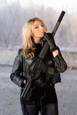 one armed: Hot girl in leather jacket holding a rifle