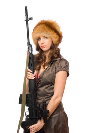 Seductive young woman in fur hat with a gun Stock Photo