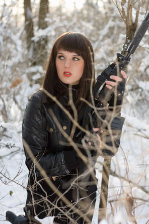 Portrait of sexy young lady with a rifle  photo