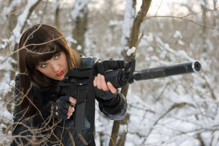 Portrait of beautiful young lady with a rifle  photo