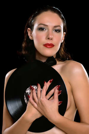 Portrait of a young brunette with vinyl photo