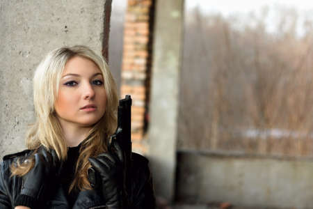 airsoft gun: Sweet blonde female with in abandoned building