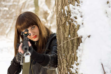 Portrait of attractive young woman with a sniper rifle  photo