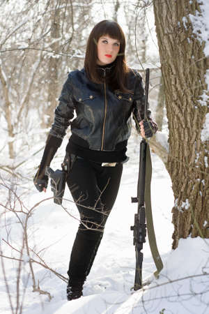 airsoft gun: Beautiful young lady with a sniper rifle