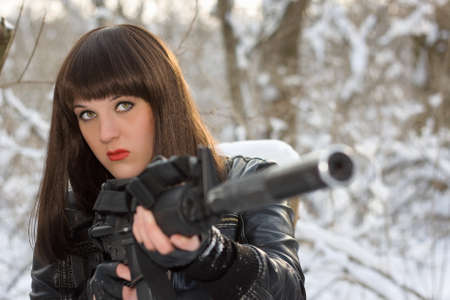 silencer: Portrait of strong young lady with a rifle  Stock Photo