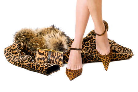 leopard fur: Pretty young feet in the spotted shoes