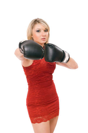 Pretty young blond woman in boxing gloves photo