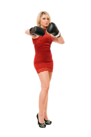 Pretty young blond lady in  boxing gloves