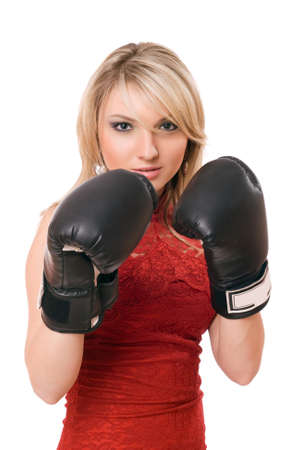 Pretty young blond girl in  boxing gloves photo