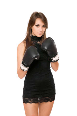 female fighter: Pretty brunette young woman in boxing gloves