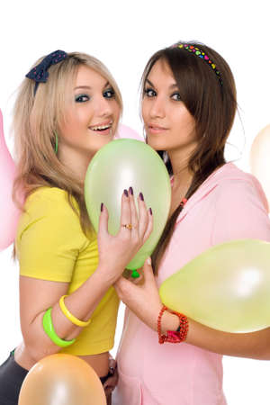 Sexy brunette and blonde holding a balloon photo