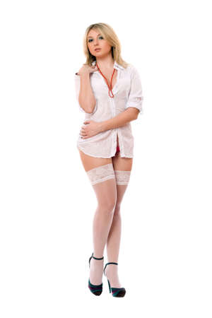 Alluring blond woman in white stockings. Isolated Stock Photo - 13249504