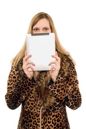 Pretty blonde covers face with the tablet pc photo