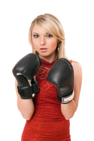 girl punch: Beautiful young blond woman in boxing gloves