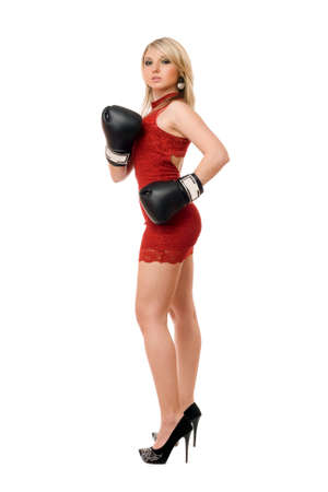 girl punch: Nice blond young girl in boxing gloves