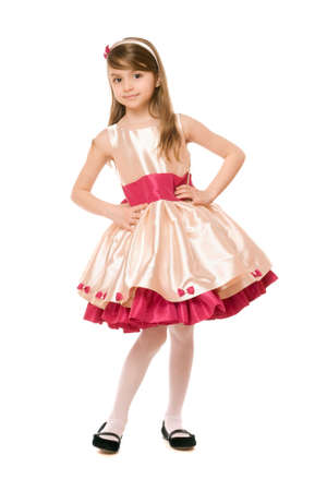Playful little lady in a dress. Isolated