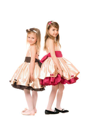 Two nice little girls in a dress. Isolated Stock Photo - 13702620