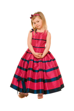 Cute little blond girl in a long dress Stock Photo - 13702622