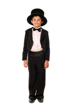 Handsome little boy in a tuxedo and hat. Isolated photo