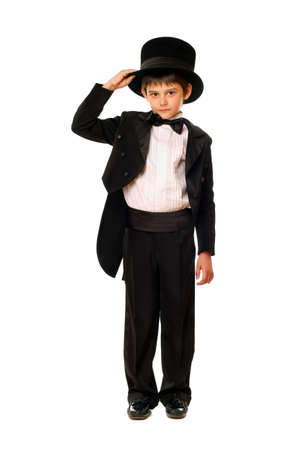 Little boy in a tuxedo and hat. Isolated photo