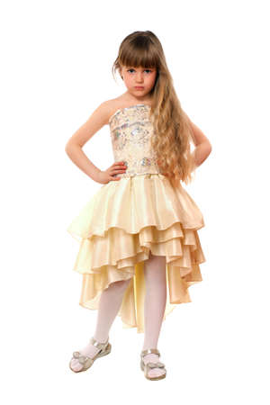 Beautiful little girl in a beige dress. Isolated Stock Photo - 13745481