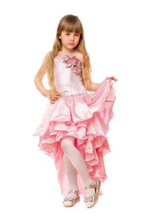 Little girl in a chic pink dress. Isolated Stock Photo - 13758708