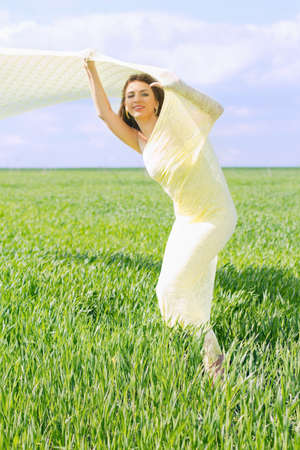 Nice young woman wrapped in yellow cloth photo
