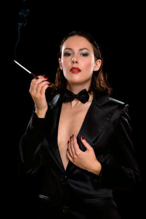 Portrait of a beautiful young woman with cigarette. Isolated photo