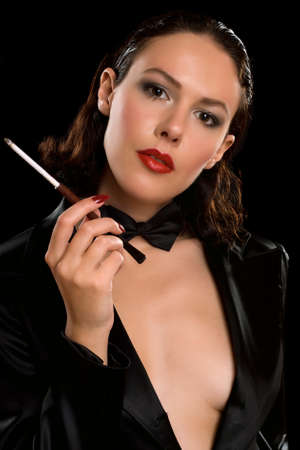 Closeup portrait of a young woman with cigarette. Isolated photo