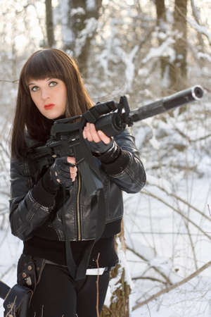 silencer: Portrait of young lady with a rifle
