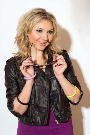 Young lovely blond woman with the goggles photo