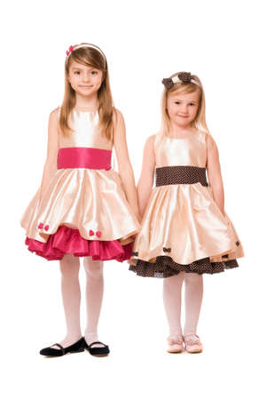 Two charming little girls in a dress. Isolated