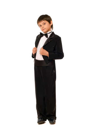 Little boy in a tuxedo. Isolated photo