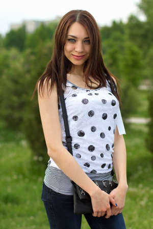 Portrait of a perfect young woman outdoors photo
