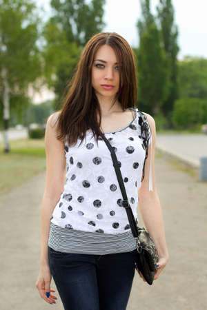 Portrait of a nice young woman outdoors photo