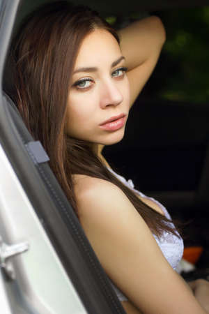 Sensual young woman sitting in the car Stock Photo - 15562995